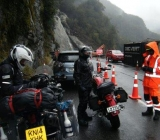 diana-fall-slip-haast-Ken-being-told-not-to-move-away-from-the-bike-by-the-man-in-orange